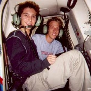 Justin Berfield taking off in a helicopter with Jason Felts