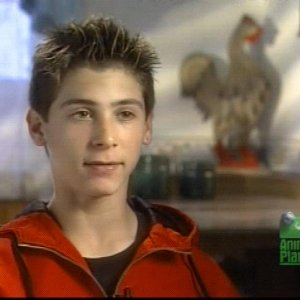 Justin Berfield with his pets in 'Hollywood Unleashed', 2002