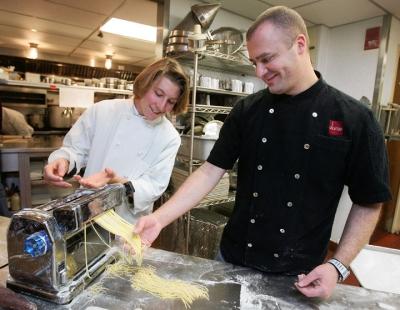 Erik Per Sullivan making pasta with chef Dante de Magistris
